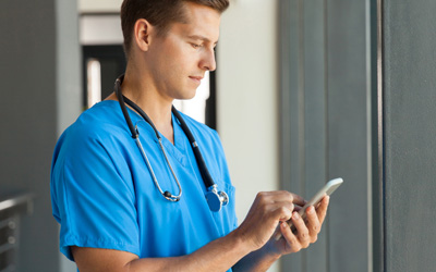 Healthcare Worker Using Mobile Technology